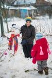 Muñeco de nieve del molde de los niños Fotos de archivo