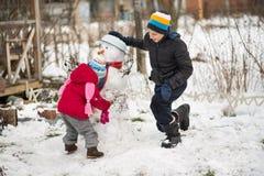 Muñeco de nieve del molde de los niños Imagen de archivo libre de regalías