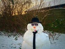 Muñeco de nieve del negocio Fotos de archivo
