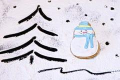 Muñeco de nieve del pan de jengibre, floured Fotos de archivo