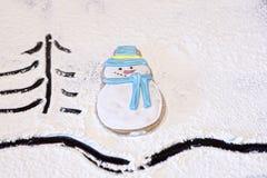 Muñeco de nieve del pan de jengibre, floured Imagen de archivo