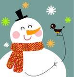 Muñeco de nieve divertido con el pájaro Fotos de archivo libres de regalías