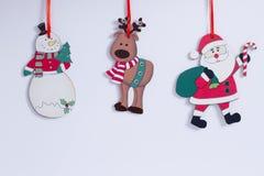 Muñeco de nieve divertido de la Navidad, reno, Santa Claus Imágenes de archivo libres de regalías