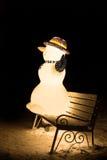 Muñeco de nieve en el banco Imagen de archivo