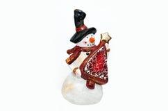 Muñeco de nieve en el fondo blanco Foto de archivo