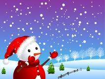 Muñeco de nieve en invierno nevoso Fotografía de archivo libre de regalías