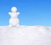 Muñeco de nieve en nieve Fotos de archivo