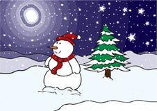 Muñeco de nieve en un campo en la noche Foto de archivo