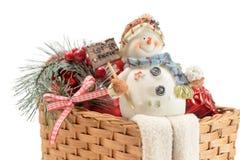 Muñeco de nieve en una cesta Fotos de archivo libres de regalías