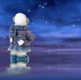 Muñeco de nieve en una noche estrellada Fotografía de archivo