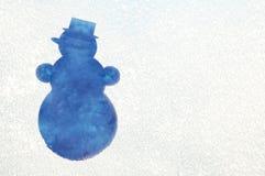 Muñeco de nieve en una ventana congelada Imagen de archivo