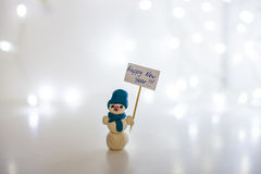 Muñeco de nieve, Feliz Año Nuevo 2016, fondo blanco, guirnalda ligera Foto de archivo libre de regalías