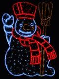 Muñeco de nieve iluminado Imágenes de archivo libres de regalías
