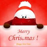 Muñeco de nieve lindo de la Navidad con el sombrero de la bufanda y de Papá Noel del rojo Foto de archivo