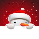 Muñeco de nieve lindo que lleva a cabo la página blanca, tarjeta de Navidad Imagen de archivo libre de regalías