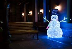 Muñeco de nieve luminoso de la Navidad Fotos de archivo