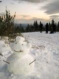 Muñeco de nieve que fuma Imagen de archivo libre de regalías