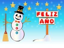 Muñeco de nieve que lleva a cabo un poste indicador feliz del año escrito en español Fotos de archivo libres de regalías