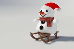 Muñeco de nieve que se sienta en los trineos de la nieve Imagen de archivo