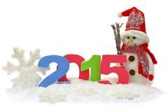 Muñeco de nieve y Año Nuevo 2015 Imágenes de archivo libres de regalías