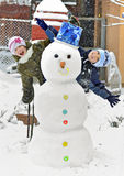 Muñeco de nieve y cabritos Foto de archivo