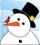 Muñeco de nieve y cardenal Foto de archivo