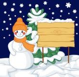 Muñeco de nieve y cartelera Foto de archivo libre de regalías