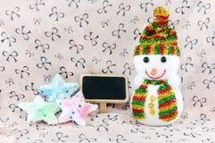 Muñeco de nieve y estrellas Imagenes de archivo