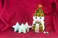 Muñeco de nieve y estrellas Imágenes de archivo libres de regalías