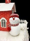 muñeco de nieve y hogar fotografía de archivo libre de regalías