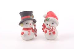 Muñeco de nieve y mujer de la nieve Foto de archivo libre de regalías