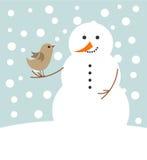 Muñeco de nieve y pájaro de la Navidad Fotografía de archivo
