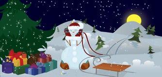 Muñeco de nieve y pájaros bajo bandera del árbol de navidad Imagenes de archivo