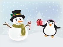 Muñeco de nieve y pingüino Imagen de archivo