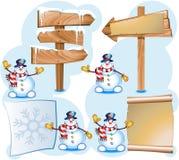Muñeco de nieve y poste indicador Fotografía de archivo libre de regalías