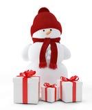 Muñeco de nieve y regalos Fotos de archivo libres de regalías