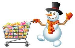 Muñeco de nieve y shoppingcart Fotografía de archivo libre de regalías