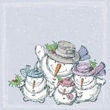 Muñecos de nieve alegres Foto de archivo libre de regalías