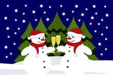 Muñecos de nieve con los vidrios de champán Foto de archivo libre de regalías