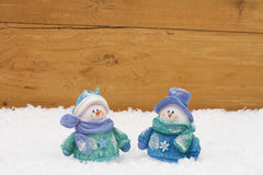 Muñecos de nieve de la Navidad con el copia-espacio Foto de archivo libre de regalías