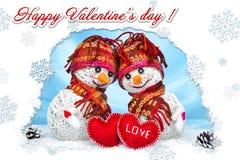 Muñecos de nieve del amor nevadas Concepto del amor Día de tarjetas del día de San Valentín feliz de la tarjeta de felicitación Fotos de archivo