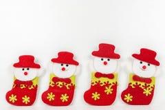 Muñecos de nieve en el fondo blanco Fotos de archivo