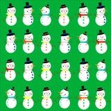 Muñecos de nieve en fondo verde Imagenes de archivo