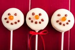 Muñecos de nieve y estallidos de la torta del reno Imágenes de archivo libres de regalías