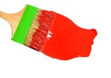 Muśnięcie z czerwoną farbą, odosobnioną na białym tle Zdjęcie Stock
