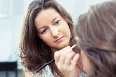 MUA applying make-up royalty free stock photo