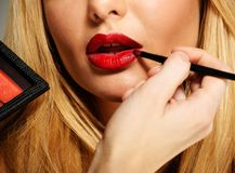 Mua artist painting lips Stock Images