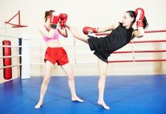 Muai thai fighting women Royalty Free Stock Image
