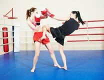 Muai thai fighting women Royalty Free Stock Photography