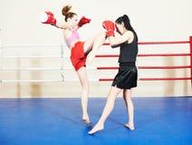 Muai thai fighting women Stock Photo